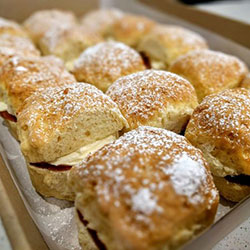 Scone with strawberry jam and cream thumbnail
