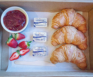Croissant with butter and jam - large thumbnail