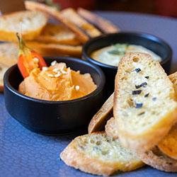 Assorted dips with crostinis thumbnail