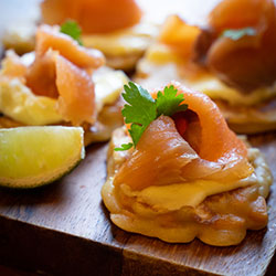 Smoked salmon on pumpkin pancakes thumbnail