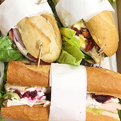 Assorted gourmet sandwiches and rolls thumbnail