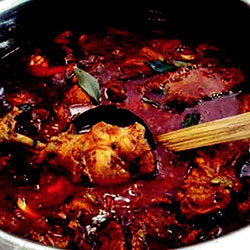 Vibrant red chicken curry  thumbnail