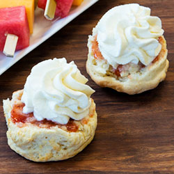 Half portion of scone with jam and cream ready to eat thumbnail
