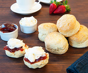 House baked scone with jam and cream thumbnail